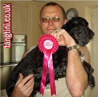 Colin and Holly showing off the Best Handler rosette. No idea how they got to win it though.